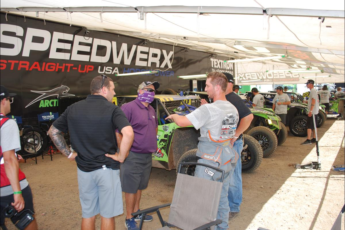 Speedwerx Team members discussing their strategy.